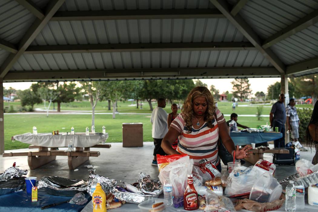 Jennifer L. grabs food during a Labor Day barbecue at Lorenzi Park in Las Vegas, Monday, Sept. 4, 2017. Joel Angel Juarez Las Vegas Review-Journal @jajuarezphoto