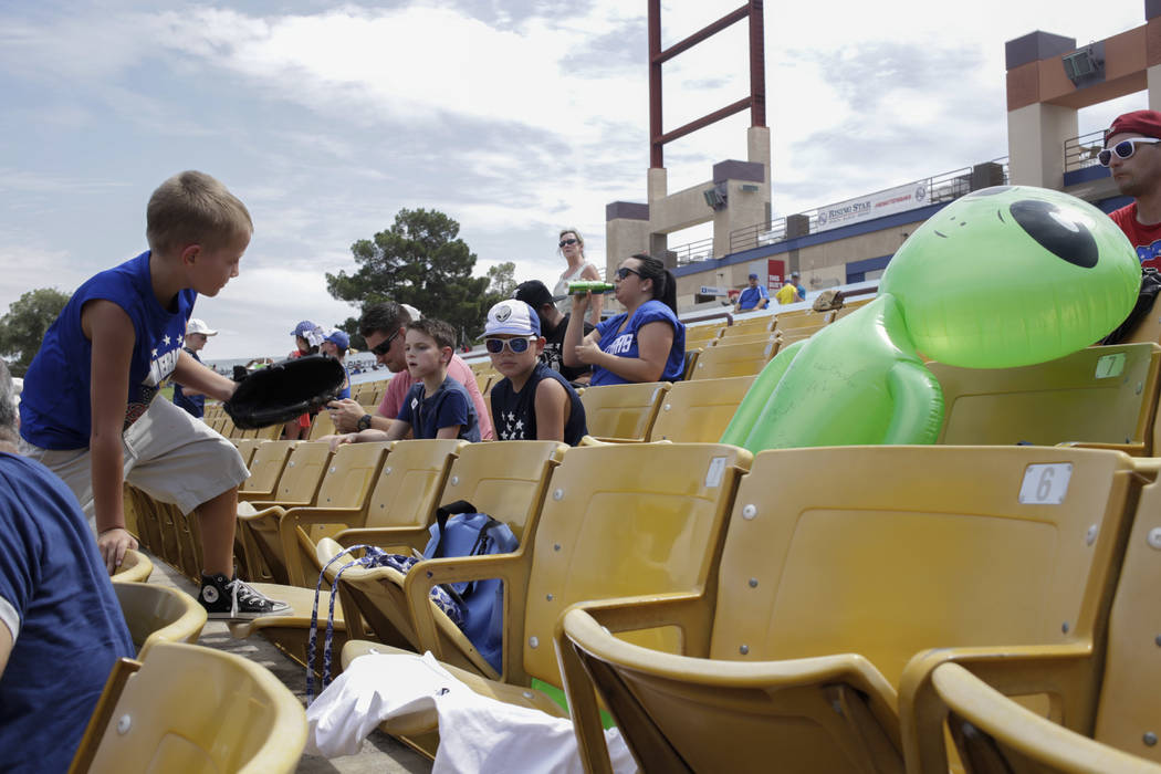 Liam Adams, left, 7, climbs over stadium seats while Shawn Adams, center, 10, hangs out and enjoys the last day of the Las Vegas 51s season at Cashman Field in Las Vegas, Monday, Sept. 4, 2017.  G ...