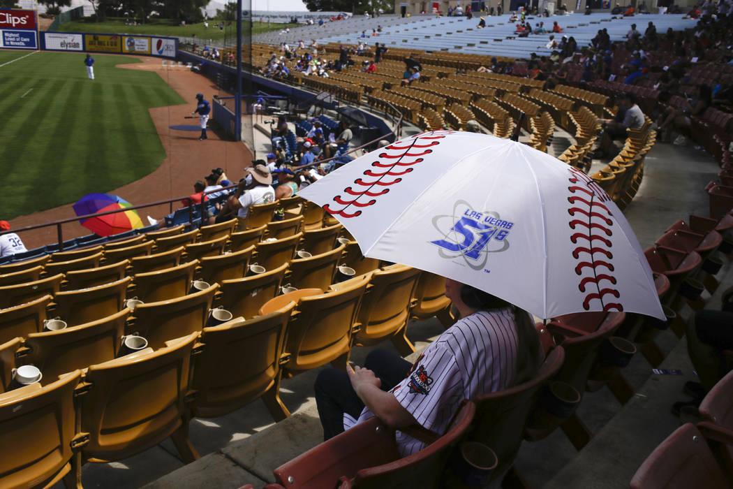 Aoife Ellis shades herself with a Las Vegas 51s themed baseball umbrella as she enjoys the last day of the Las Vegas 51s season at Cashman Field in Las Vegas, Monday, Sept. 4, 2017.  Gabriella Ang ...