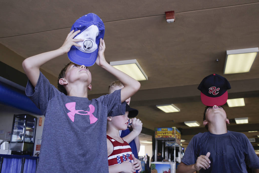 Chase Gilbert, 8, left, and Dane Gilbert, 11, both of Las Vegas, balance hats on their on noses on the last day of the Las Vegas 51s season at Cashman Field in Las Vegas, Monday, Sept. 4, 2017.  G ...