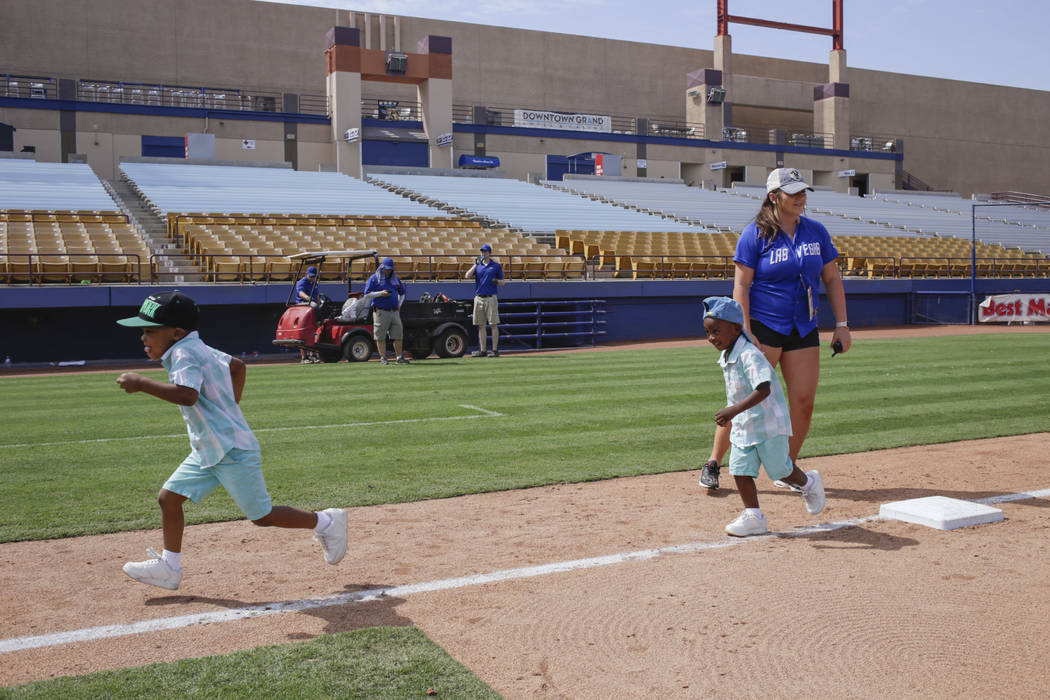 Jerimiah, 4 1/2 , left, and Scott, 3, right, who only gave their first names, run bases after the last game of the Las Vegas 51s season at Cashman Field in Las Vegas, Monday, Sept. 4, 2017.  Gabri ...