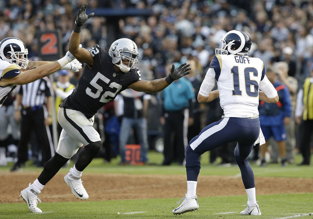 Oakland Raiders defensive end Khalil Mack (52) sacks Los Angeles Rams quarterback Jared Goff (16) during the first half of an NFL preseason football game in Oakland, Saturday, Aug. 19, 2017. (AP P ...