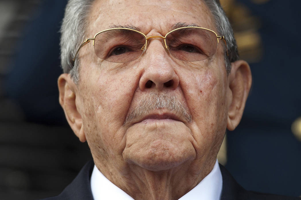 FILE - In this March 17, 2015 file photo, Cuba's President Raul Castro listens to the playing of national hymns during his welcoming ceremony at Miraflores presidential palace before the start of  ...