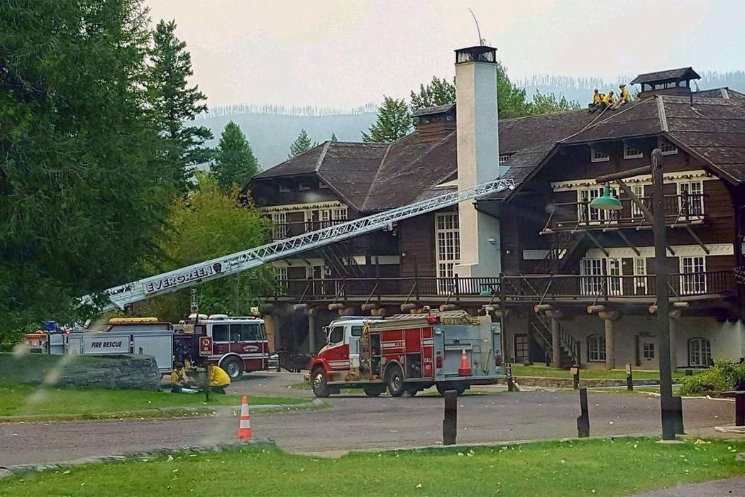 A firetruck is positioned outside The 103-year-old Lake McDonald Lodge in Glacier National Park, Montana, as firefighters prepare for a blaze that is threatening the century-old Swiss chalet-style ...