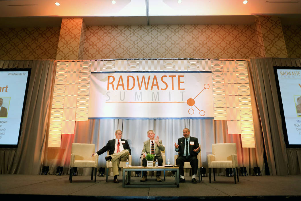 Moderator and the Vice President of Strategic Development for Nuclear and Environment  Eric Knox, left,  executive director of the Agency for Nuclear Projects Robert J. Halstead, center, and commi ...