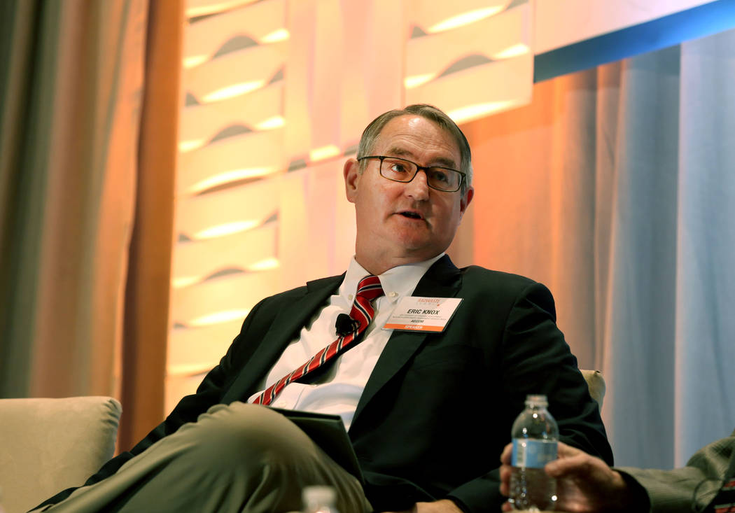 Moderator and the Vice President of Strategic Development for Nuclear and Environment Eric Knox asks questions regarding the pros and cons of restarting the Yucca Mountain Project at the JW Marrio ...