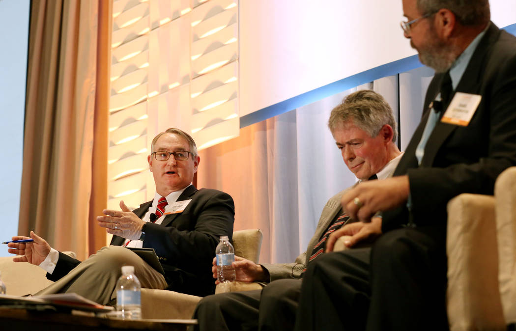 Moderator and the Vice President of Strategic Development for Nuclear and Environment Eric Knox, left,  asks questions to executive director of the Agency for Nuclear Projects Robert J. Halstead,  ...