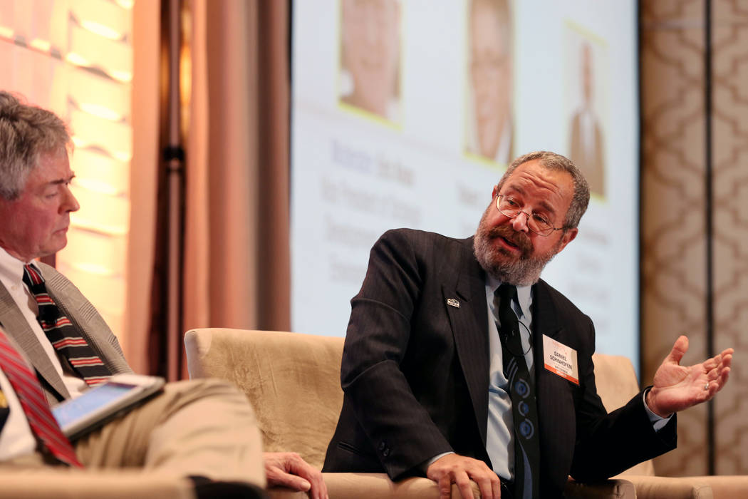 Commissioner and chairman of the Board of Nye County Dan Schinhofen, right, debates with and executive director of the Agency for Nuclear Projects Robert J. Halstead regarding the pros and cons of ...