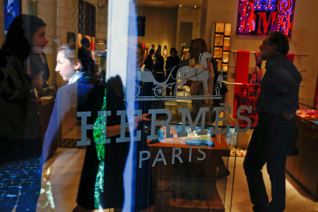 People inside the new Hermes boutique in Rome, Italy, Oct. 7, 2016. (Tony Gentile/Reuters)