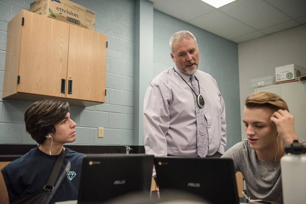 Chemistry teacher Arthur Cassman speaks with juniors Kaden Gandulla, left, and Dillon Harrington, right, at Shadow Ridge High School on Wednesday, Sep. 6, 2017, in Las Vegas. Morgan Lieberman Las  ...