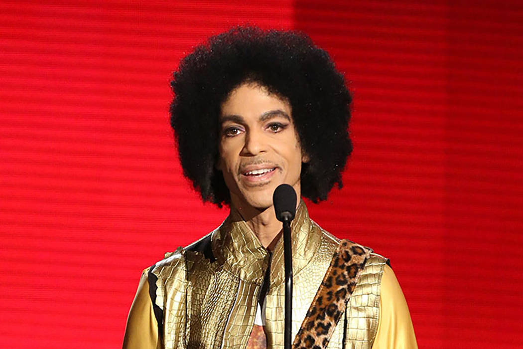 Prince presents an award Nov. 22, 2015, at the American Music Awards in Los Angeles. (Matt Sayles/Invision/File, AP)