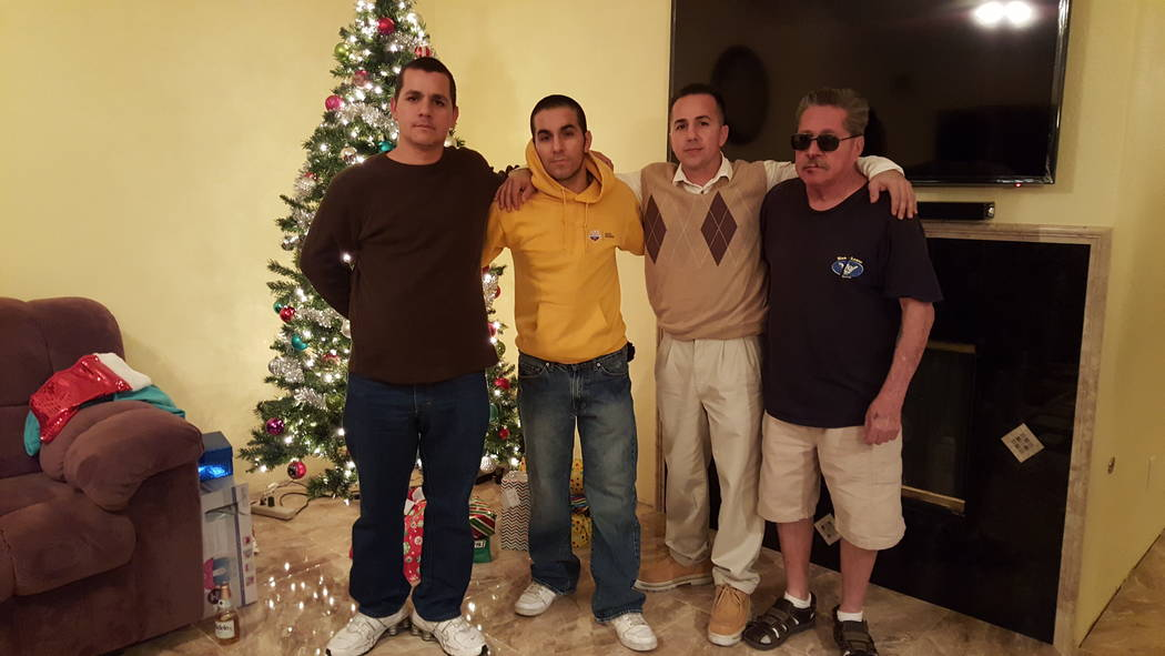 Robert Gamboa, right, celebrates his last Christmas with three of his five sons: from left, Robert Gamboa Jr., Chris Gamboa and Tony Gamboa. (Courtesy of Tony Gamboa)