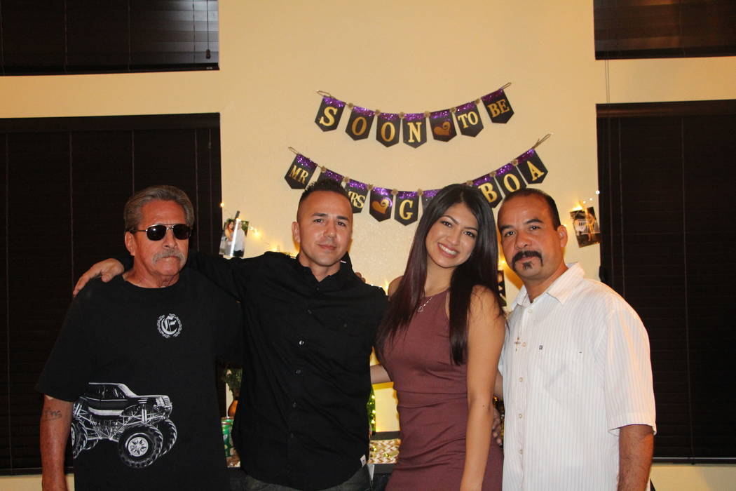 Robert Gamboa, left, celebrates his son Tony Gamboa's engagement to Brianna Valadez with her father, Roger Valadez, right. (Courtesy of Tony Gamboa)