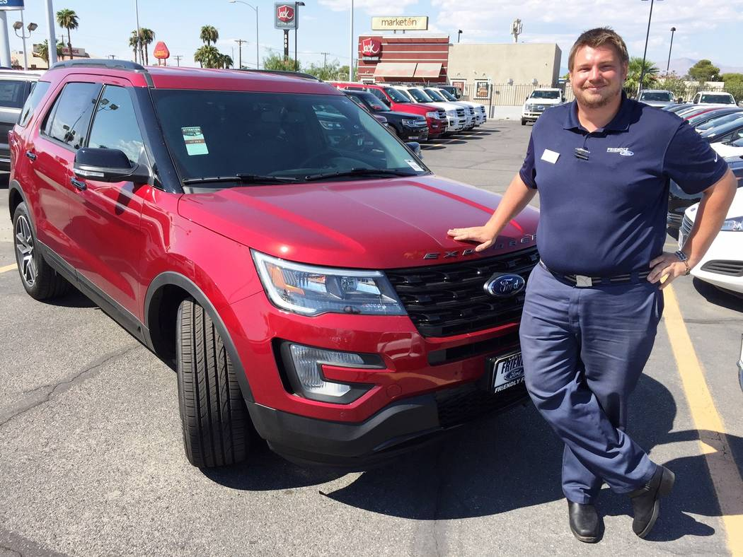 Friendly Ford Friendly Ford sales consultant Logan Meyer shows off the 2017 Ford Explorer four-wheel drive at the dealership situated at 660 N. Decatur Blvd.