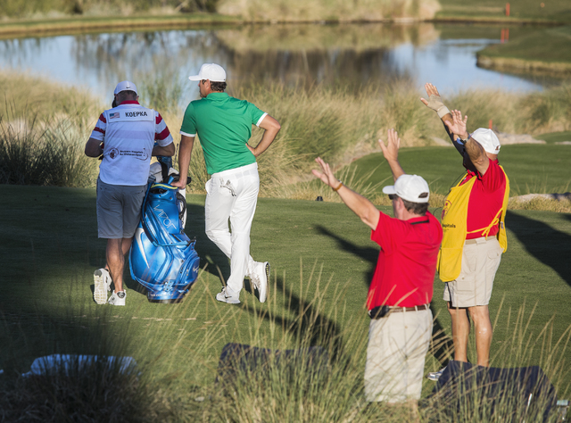 Brooks Koepka and his caddy lean against his golf bag on the 17th hole during the Shriners Hospitals for Children Open on Friday, Nov. 4, 2016. Kopeka shot 67 for the day and is in second place at ...