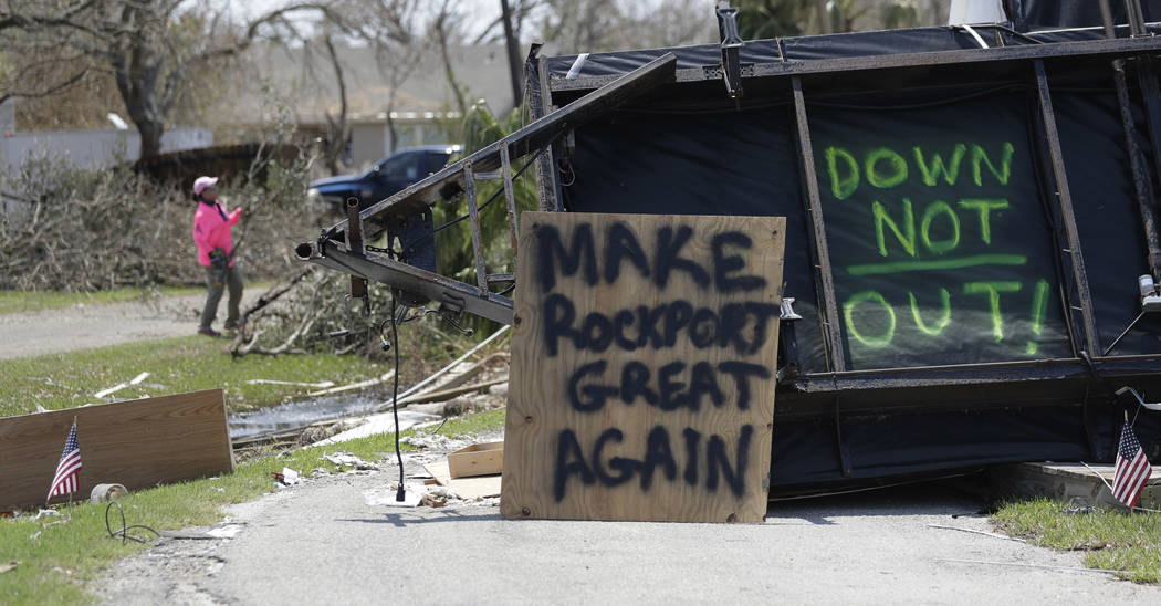 """In this Sept. 2, 2017, photo, the messages """"Make Rockport Great Again"""" and """"Down Not Out"""" are written at a destroyed home in Rockport, Texas. Rockport and Port  ..."""