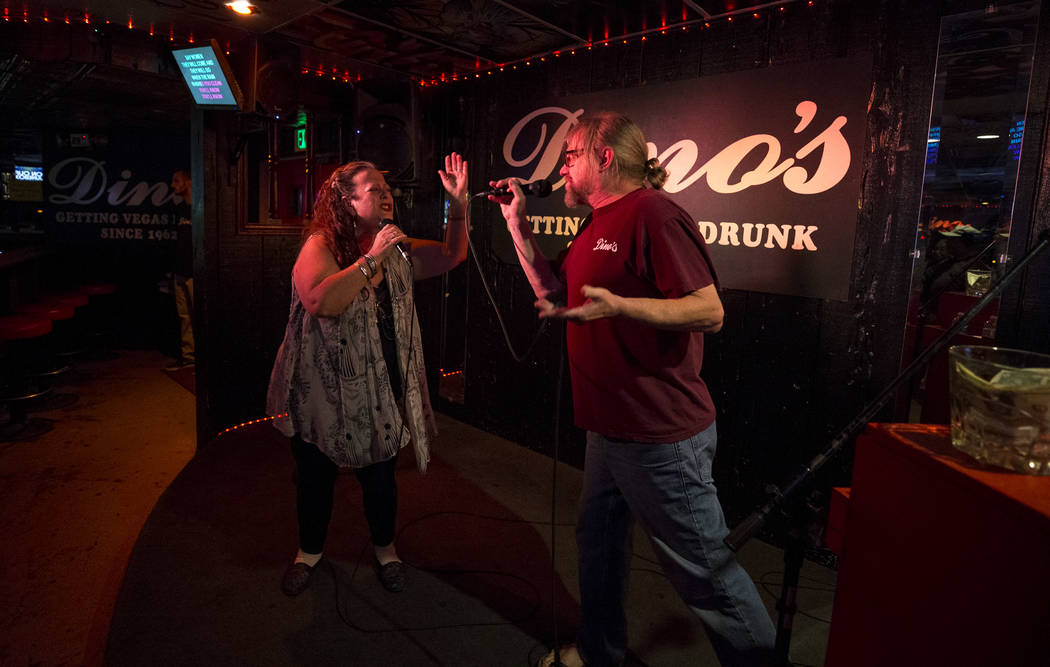 Karaoke disc jockey Danny G, right, duets with Katie Stephens during karaoke night at Dino's Lounge in downtown Las Vegas on Thursday, Aug. 31, 2017.  Richard Brian Las Vegas Review-Journal @vegas ...