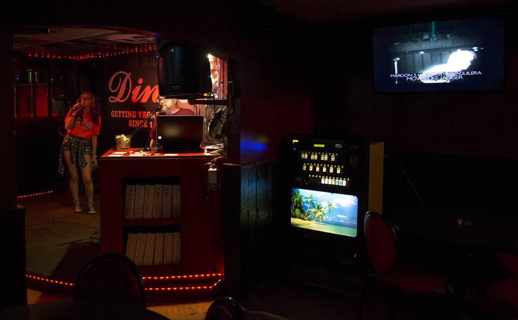 A patron sings during karaoke night at Dino's Lounge in downtown Las Vegas on Thursday, Aug. 31, 2017.  Richard Brian Las Vegas Review-Journal @vegasphotograph