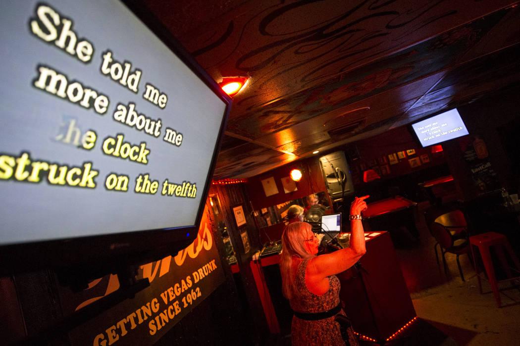 Las Vegas resident Monika Landon sings during karaoke night at Dino's Lounge in downtown Las Vegas on Thursday, Aug. 31, 2017.  Richard Brian Las Vegas Review-Journal @vegasphotograph