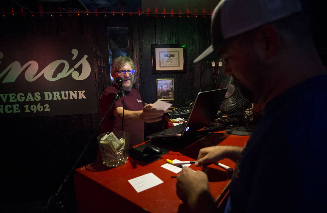 Karaoke disc jockey Danny G, left, gets a song request from a customer during karaoke night at Dino's Lounge in downtown Las Vegas on Thursday, Aug. 31, 2017.  Richard Brian Las Vegas Review-Journ ...