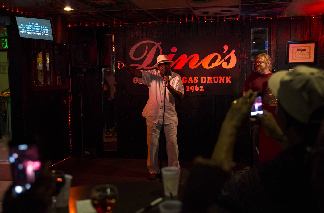 Henry Thomas of Texas sings karaoke at Dino's Lounge in downtown Las Vegas on Thursday, Aug. 31, 2017.  Richard Brian Las Vegas Review-Journal @vegasphotograph
