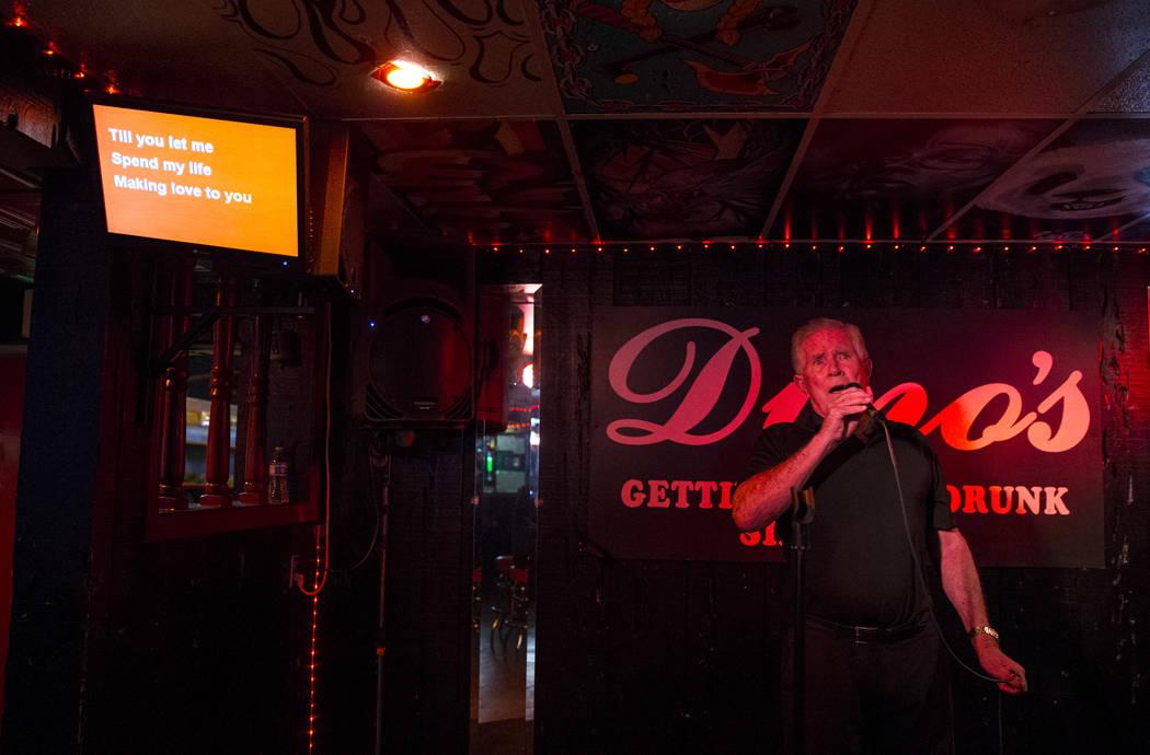 Las Vegas resident Tony Kahmann sings during karaoke night at Dino's Lounge in downtown Las Vegas on Thursday, Aug. 31, 2017.  Richard Brian Las Vegas Review-Journal @vegasphotograph