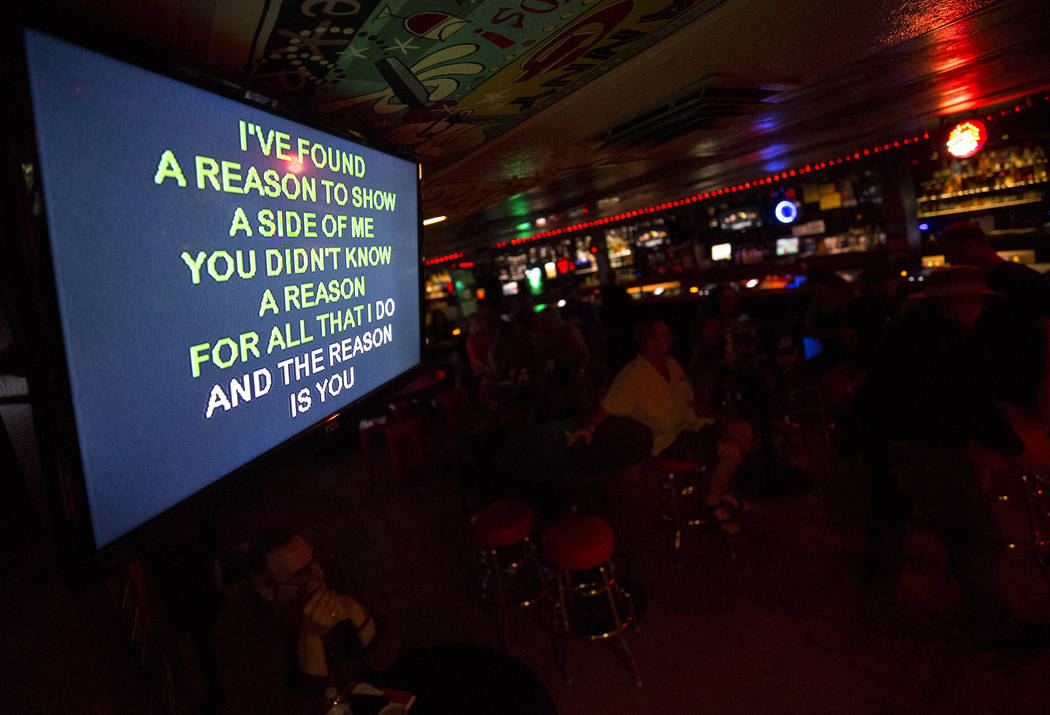 Song lyrics on a monitor during karaoke night at Dino's Lounge in downtown Las Vegas on Thursday, Aug. 31, 2017.  Richard Brian Las Vegas Review-Journal @vegasphotograph