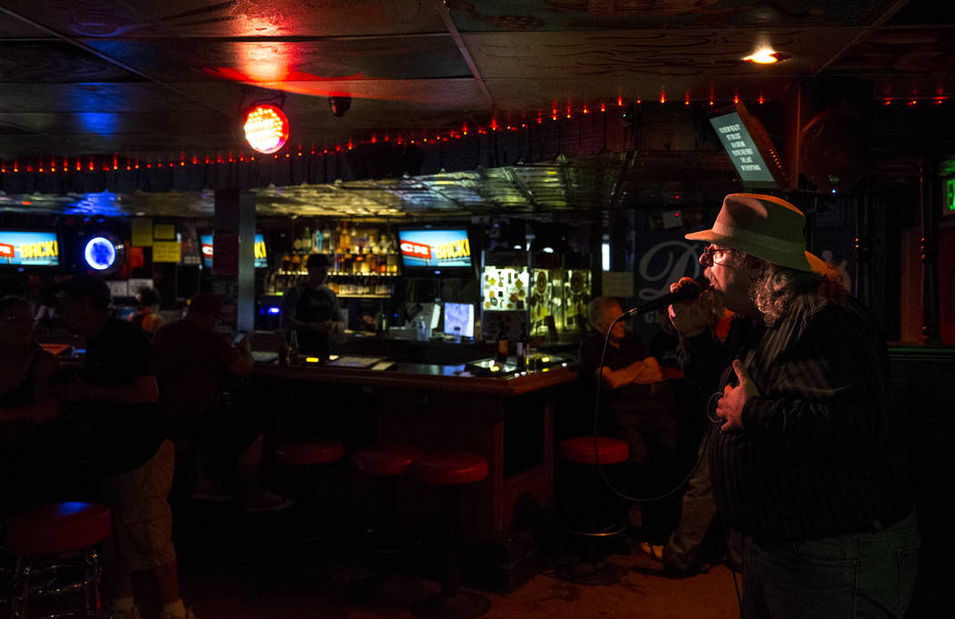 Las Vegas resident Anthony Saxton sings during karaoke night at Dino's Lounge in downtown Las Vegas on Thursday, Aug. 31, 2017. Saxton says he's been going to Dino's for about 10 years. Richard Br ...