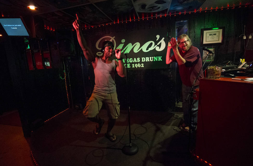 Karaoke disc jockey Danny G, rights, duets with Kingsley Nwankwo during karaoke night at Dino's Lounge in downtown Las Vegas on Thursday, Aug. 31, 2017.  Richard Brian Las Vegas Review-Journal @ve ...