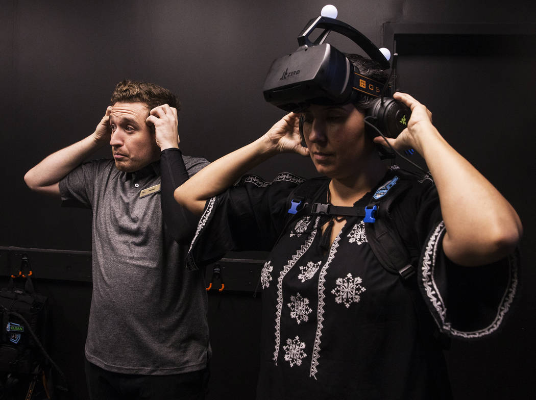 Phillip Persi, left, helps Leticia Carrillo with her head phones before entering the gaming arena at Level Up on Tuesday, September 5, 2017, at the MGM Grand hotel-casino, in Las Vegas. Benjamin H ...