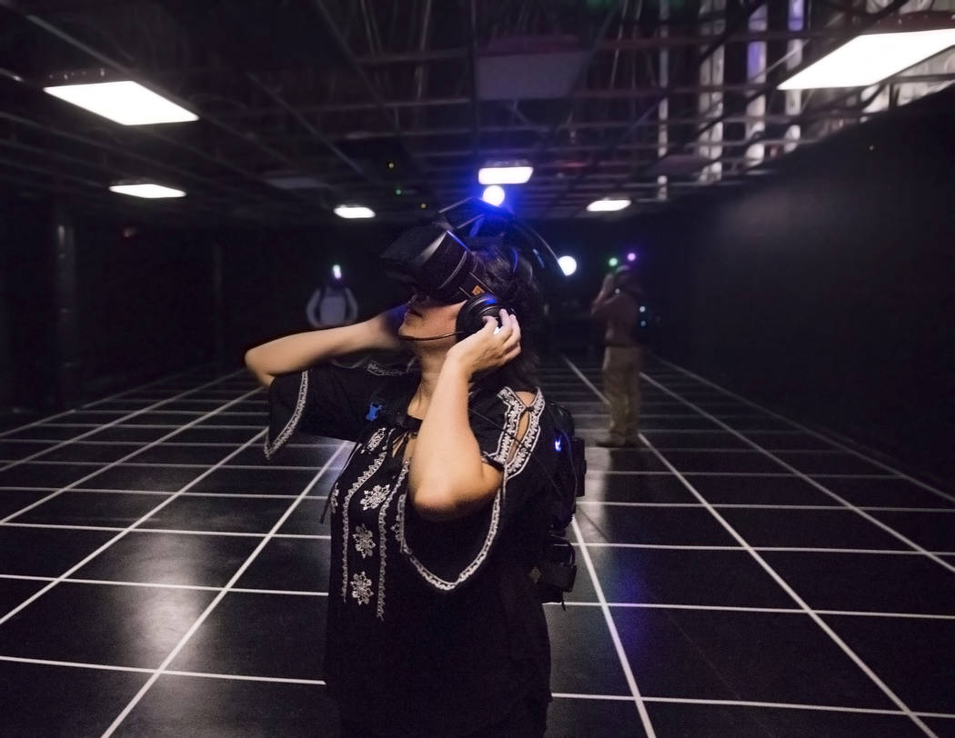 "Leticia Carrillo makes a last minute adjustment to her virtual reality goggles before the start of the game ""Engineerium"" at Level Up on Tuesday, September 5, 2017, at the MGM Gr ..."