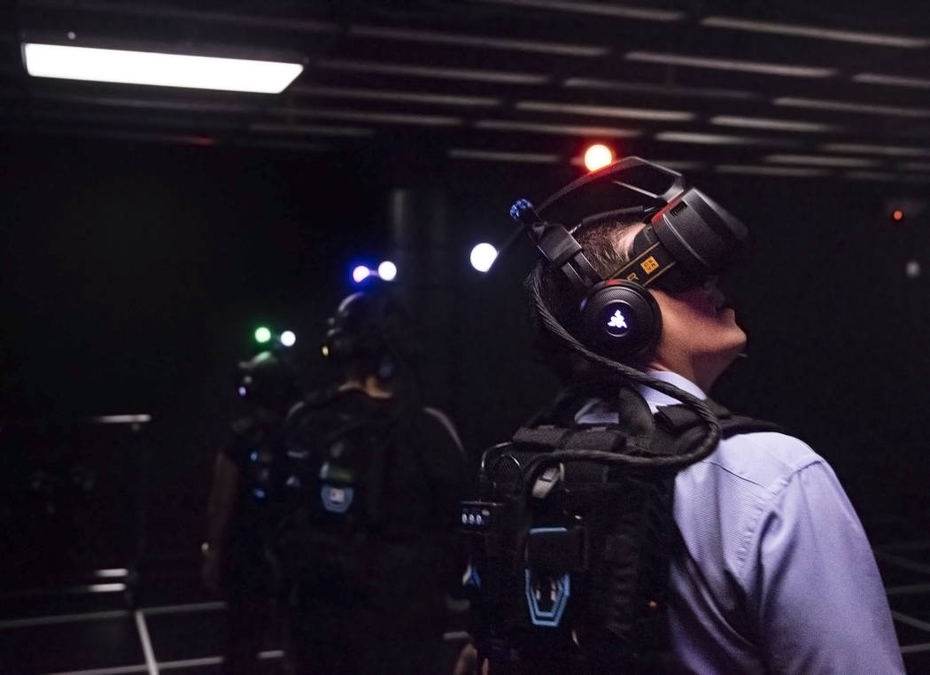"""Matt Pinal, right, familiarizes himself with his virtual reality goggles before the start of the game """"Engineerium"""" at Level Up on Tuesday, September 5, 2017, at the MGM Grand ho ..."""