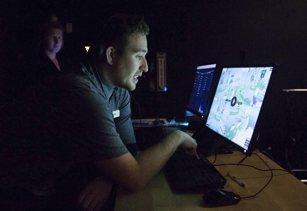 """Phillip Persi, middle, guides players through the game """"Engineerium"""" at Level Up on Tuesday, September 5, 2017, at the MGM Grand hotel-casino, in Las Vegas. Benjamin Hager Las Ve ..."""