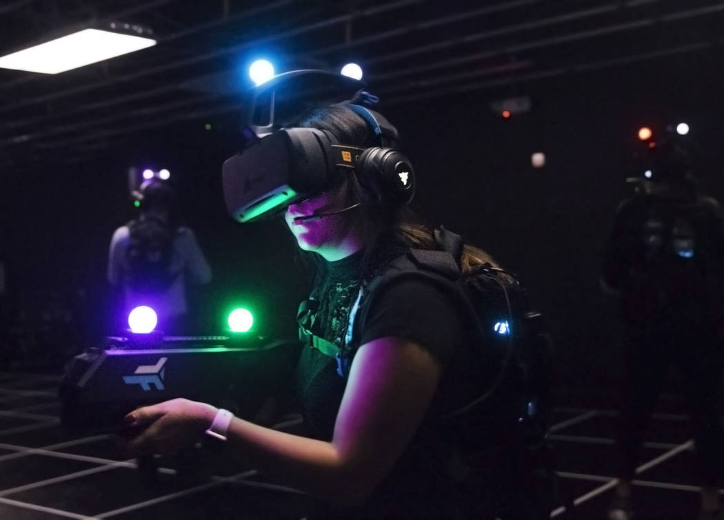 "Joslyn Garcia, middle, hunts for targets while playing ""Zombie Survival"" at Level Up on Tuesday, September 5, 2017, at the MGM Grand hotel-casino, in Las Vegas. Benjamin Hager La ..."
