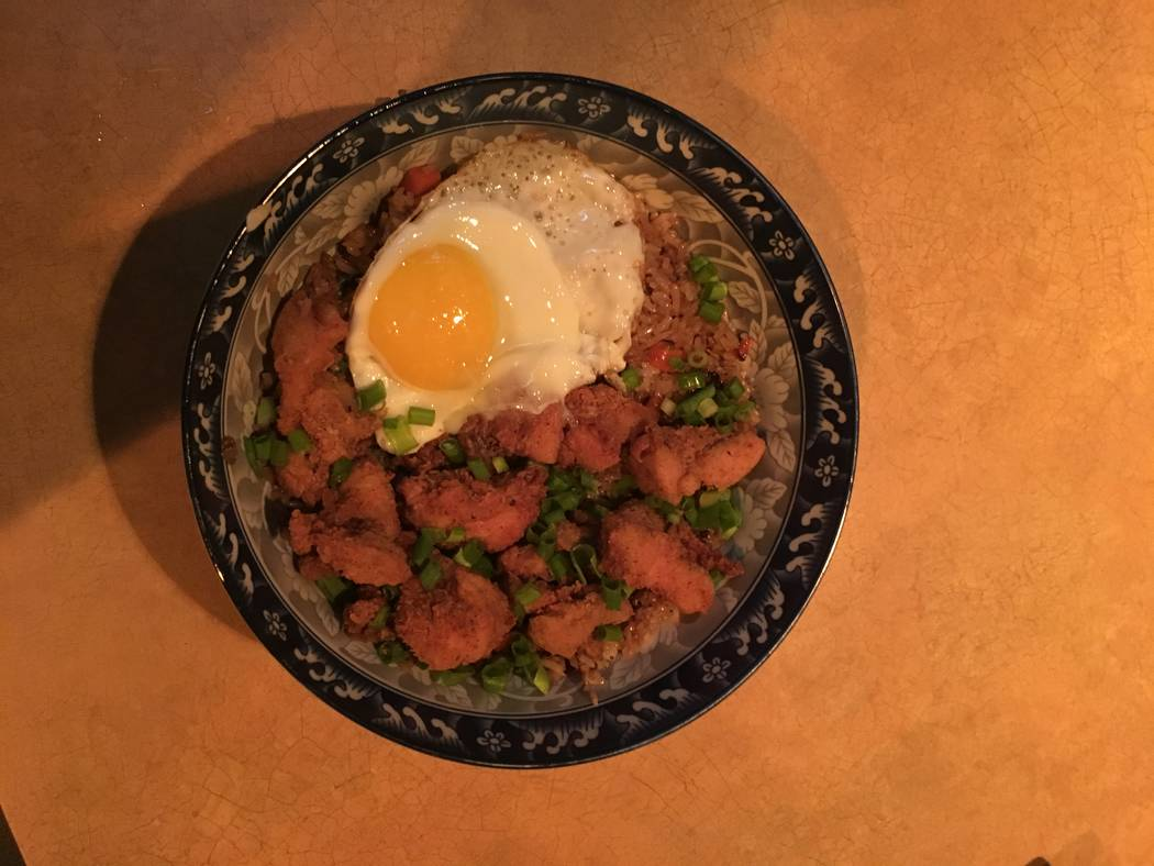 The fried chicken fried rice comes with an egg on top of the dish, one of the popular items on the Starboard Tack's menu. (Katelyn Umholtz/Las Vegas Review-Journal) @kumh0ltz