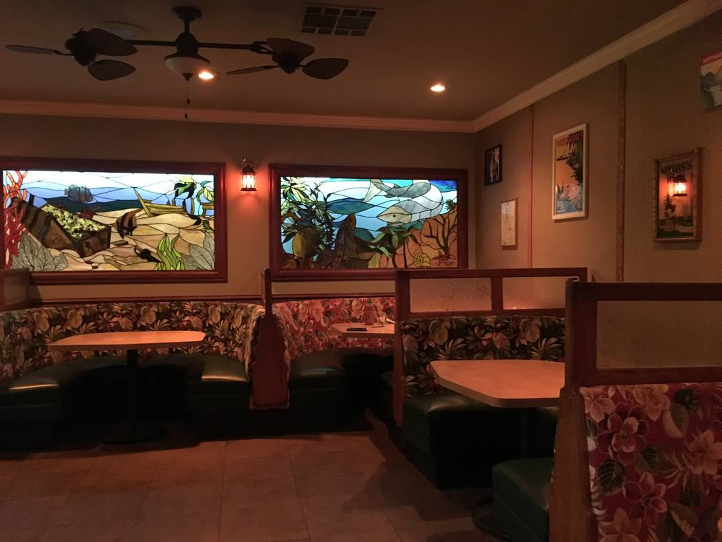 The new owners of Starboard Tack, Bryant Jane and Lyle Cervenka, kept some of the original bar's decor, such as the stained-glass windows displaying aquatic themes. (Katelyn Umholtz/Las Vegas Revi ...