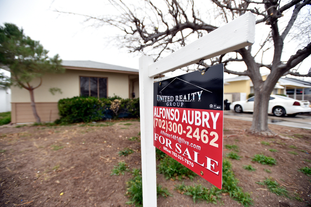 A for sale sign is displayed in front of a downtown home Tuesday, Jan. 19, 2016, in Las Vegas. David Becker/Las Vegas Review-Journal file photo
