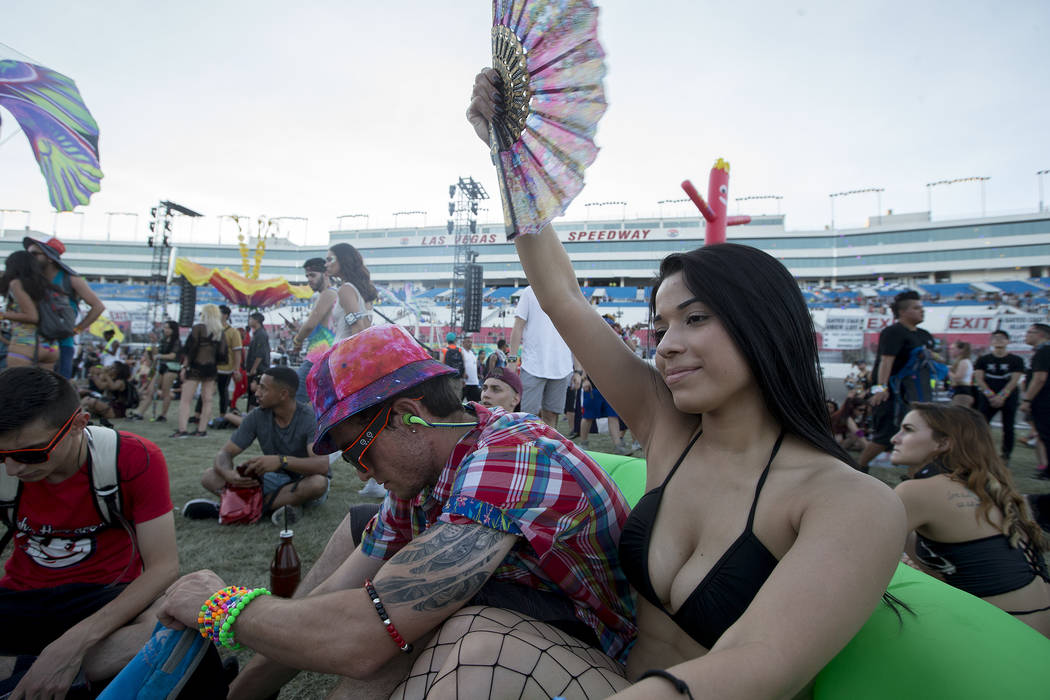Gaby Contreras from Honduras fans herself at the start of the last night of Electric Daisy Carnival at Las Vegas Motor Speedway on Sunday, June 18, 2017 in Las Vegas. Temperatures were above 105 d ...