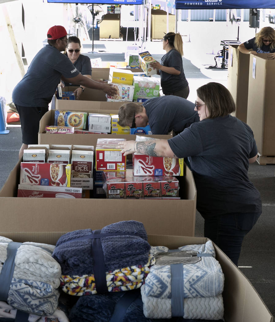 Zappos employees, including Precious Bucher, right, Cody Britton, second right, and Andre Narcesse, left, sort out donations in downtown Las Vegas for survivors of Hurricane Harvey on Tuesday, Sep ...