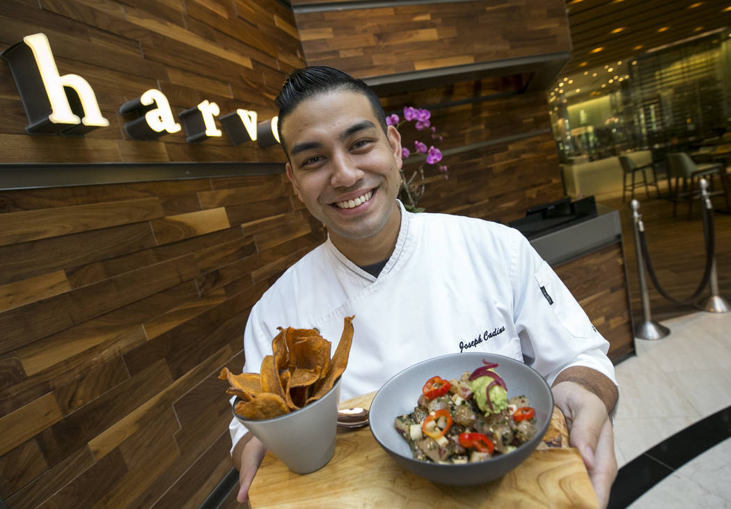 Executive sous chef Joseph Cadina with a Kampachi poke dish he prepared on Thursday, Sept. 7, 2017, at Roy Ellermar's Harvest in the Bellagio. Richard Brian Las Vegas Review-Journal @vegasphotograph
