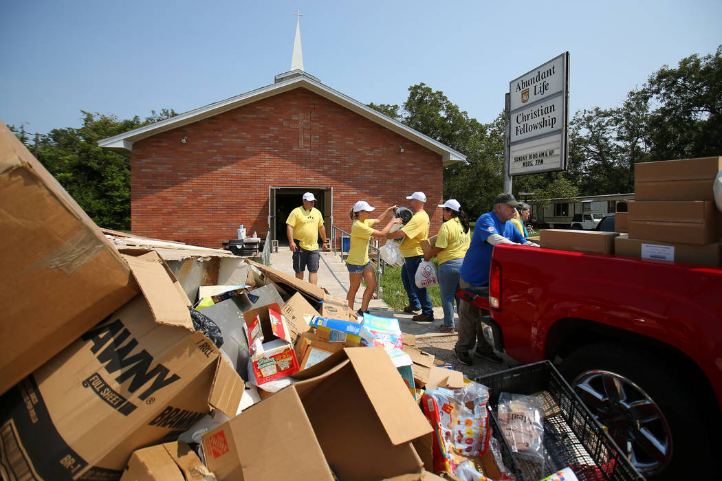 Volunteers from Kyani help load donated supplies from the Convoy of Hope into the flood damaged Abundant Life Christian Fellowship church following the aftermath of tropical storm Harvey in Wharto ...