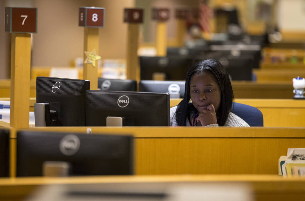 Deputy Assessor Tamicka Washington works at her desk at the Clark County Assessor's office in Las Vegas on Friday, Sept. 8, 2017. Richard Brian Las Vegas Review-Journal @vegasphotograph