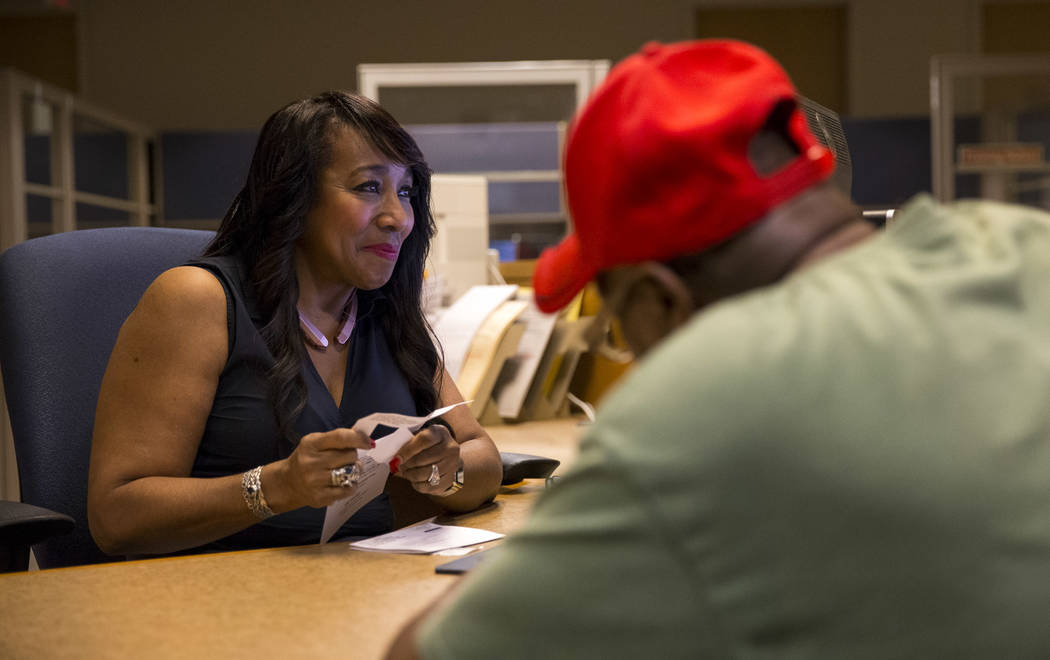 Deputy Assessor Charisse Thomas, left, helps Las Vegas resident George Dewitt with a transaction at the Clark County Assessor's office in Las Vegas on Friday, Sept. 8, 2017. Richard Brian Las Vega ...