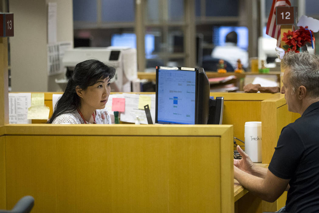 Deputy assessor Rika Nagao-Tait, left, helps a customer with a transaction at the Clark County Assessor's office in Las Vegas on Friday, Sept. 8, 2017. Richard Brian Las Vegas Review-Journal @vega ...