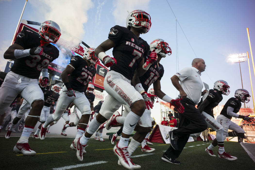 Tony Sanchez and the UNLV football team run out onto the field before their game against Howard at Sam Boyd Stadium on Saturday, Sept. 2, 2017. (Chase Stevens/Las Vegas Review-Journal)