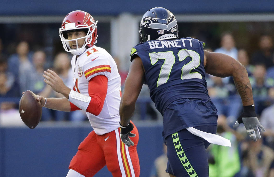 Seattle Seahawks defensive end Michael Bennett (72) pressures Kansas City Chiefs quarterback Alex Smith during the first half of an NFL football preseason game, Friday, Aug. 25, 2017, in Seattle.  ...