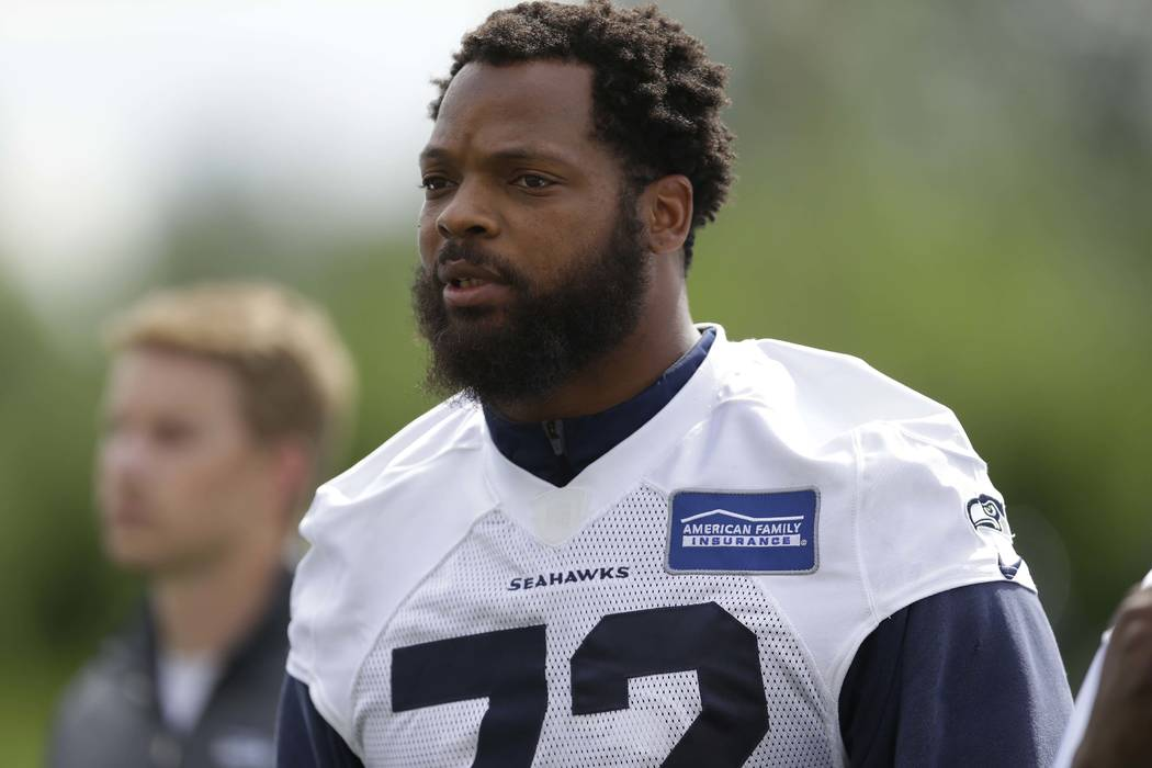 Seattle Seahawks defensive end Michael Bennett says he will sit during the national anthem this season to protest social injustice and segregation. (Ted S. Warren/AP, File)