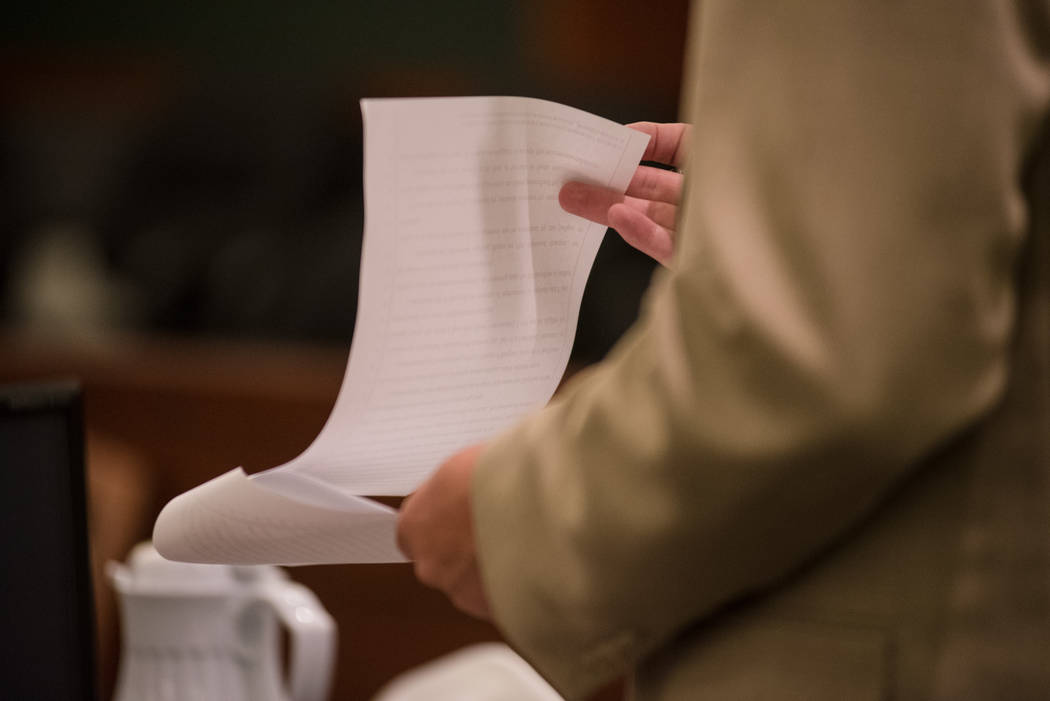 Defense lawyer Bryan Cox reads the guilty plea agreement for Robert Graham during a court hearing on Thursday, Sep. 7, 2017, at Regional Justice Center in Las Vegas. Morgan Lieberman Las Vegas Rev ...