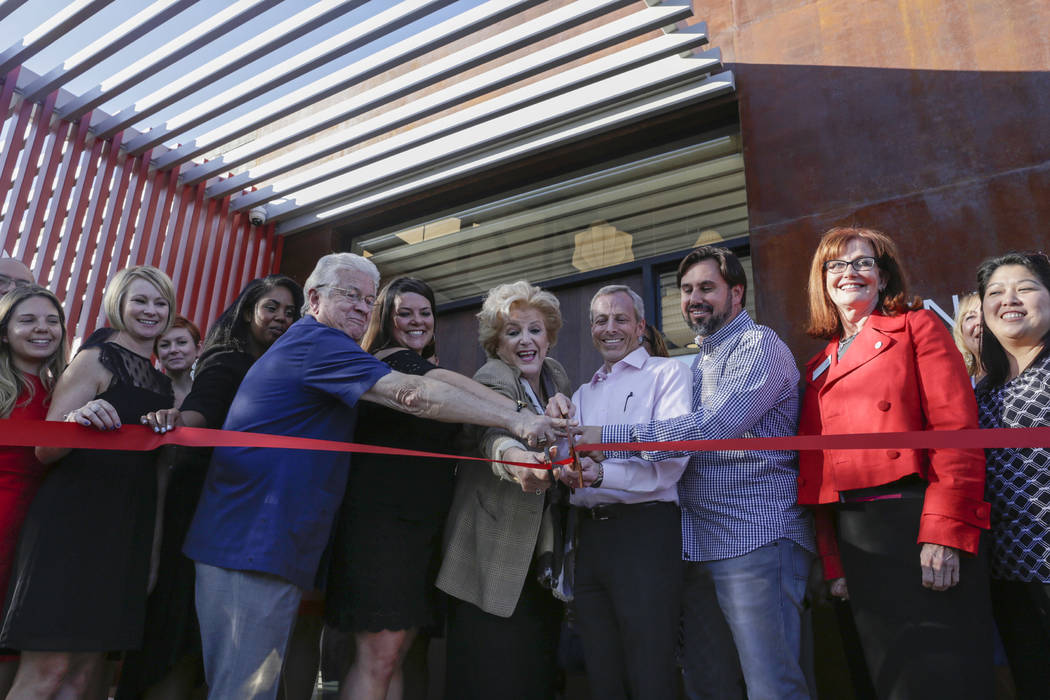 Guests of the Henriksen/Butler's ribbon-cutting ceremony, Bob Coffin, Las Vegas city councilman, from left, Heather Bressler, vice president at Henriksen/Butler Nevada, Las Vegas Mayor Carolyn Goo ...