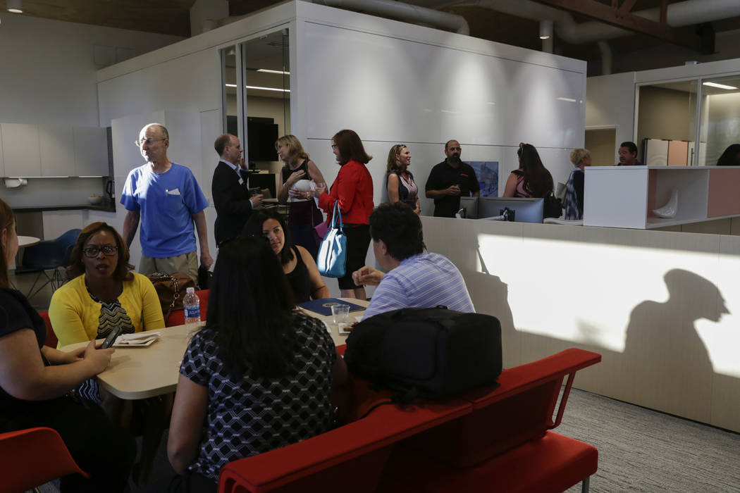 Attendees and employees at Henriksen/Butler's ribbon-cutting ceremony and open house at the company's new offices in Las Vegas, Thursday, Sept. 14, 2017. The building used to be the Gamblers Book  ...